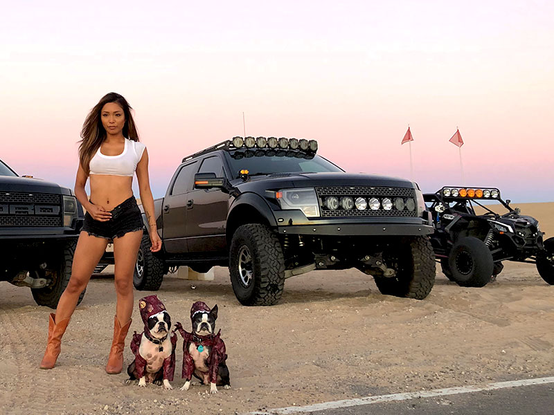 Picture of Gen 1 Raptor and X3 with cute girl and pups